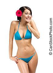Woman wearing bikini and flower in hair - Portrait of woman...
