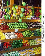 Thai Market - Variety of fruits and vegtables at fruit stand...