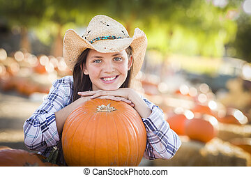 Preteen Girl Portrait at the Pumpkin Patch - Portrait of...