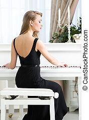 costas, vista, femininas, Pianista, sentando, tocando, piano