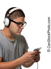 Guy Listening to Music - A young man listens to music with a...