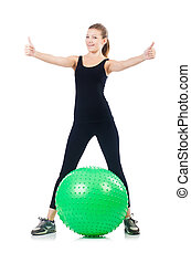 Woman exercising with swiss ball on white