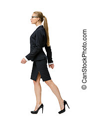 Profile of walking businesswoman, isolated on white. Concept...