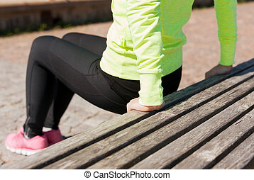 woman doing sports outdoors - sport, fitness, exercise and...