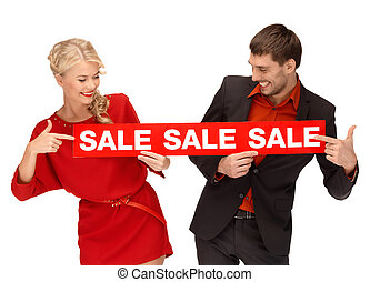 woman and man with red sale sign