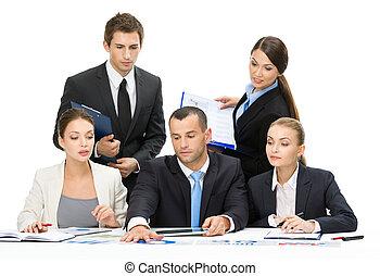 Group of business people debating