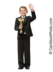 Full length portrait of little businessman with gold cup