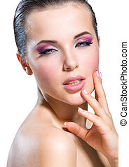 Touching face nude girl with brilliant pink make-up -...