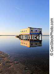 Old historic life-guard bulding in Fuseta, at Ria Formosa conservation park, Algarve. Portugal