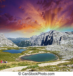 Beautiful lakes and peaks of Dolomites. Summer sunset over...