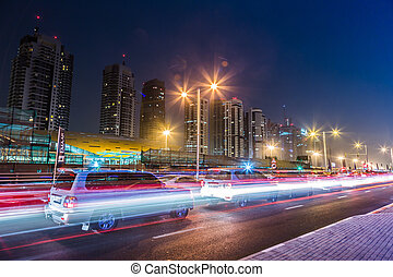 Dubai Dowtown at ngiht, United Arab Emirates - DUBAI, UAE -...