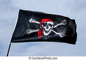 Pirates flag  - Jolly Roger, Pirates flag against blue sky.