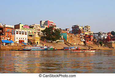 Traditional boat trip in ganjes river at sunrise, Varanasi,...