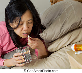 Mature Woman taking Single pill with water - Photo of mature...