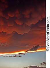 Mammatus clouds at sunset ahead of violent thunderstorm -...