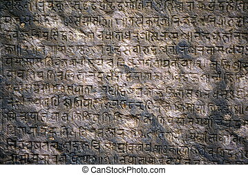 Ancient sanskrit text on a stone - Background with ancient...