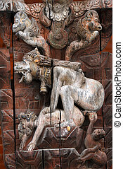 Erotic carving on a temple. Nepal - Erotic carving on a...