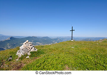 Cross Mountain - cross installed in on a green ridge in...