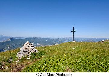 Cross Mountain - cross installed in on a green ridge in...