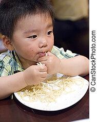 eating baby to grab pasta
