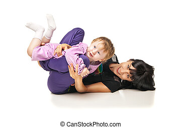 Mother with the baby doing exercises over white