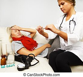 Sick young woman and doctor looking at thermometer