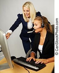 Beautiful help desk office support woman with female boss...