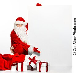 Santa Claus with sack full of gift boxes and blank notice...