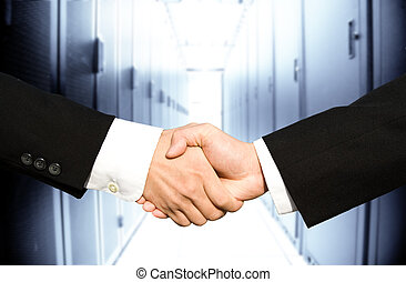 Businessmen shaking hands - Two businessmen shaking hands in...