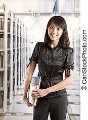 College student at library - An asian college student...