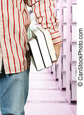 College student at library - A college student carrying...