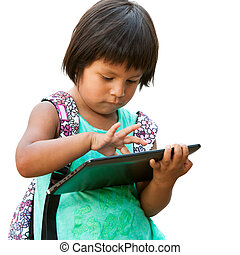 Cute native american girl typing on tablet. - Portrait of...