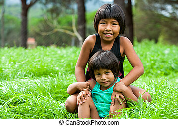 Two bolivian girls outdoors. - Portrait of two latin...