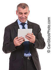 business man reads from tablet