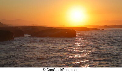 Sunset above Ribadeo in summer evening, Spain - Sea waves...