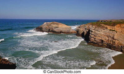 Sand beach in sunny day, Ribadeo, Spain - Sea waves rolling...