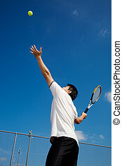 Asian playing tennis - A young sporty asian male playing...