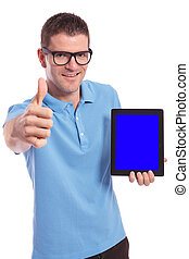 casual man presents a tablet and shows the thumb up gesture