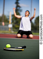 Winning tennis player - A happy tennis player in joy after...