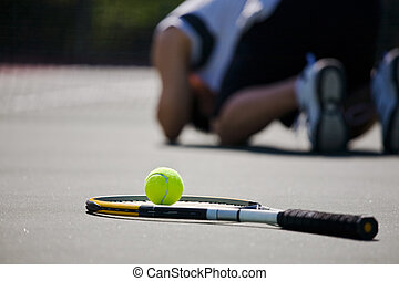 Sad tennis player after defeat - A shot of a sad tennis...