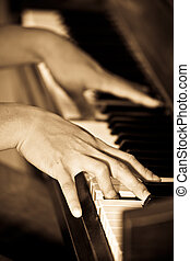 Playing piano - A closeup shot of a man playing piano