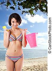 Black bikini woman at the beach - A beautiful black woman in...