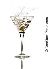 splash - Olive splashing on martini isolated on white stock...
