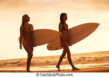 Surfer Girls on the Beach at Sunset in Hawaii - Beautiful...