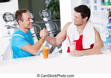 Healthy lifestyle Two confident men in gym bar