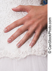 Bridal Hand - Hand of a bride on her wedding gown