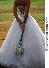 Bridal Gown - Beautiful bridal gown and bouquet at a wedding...