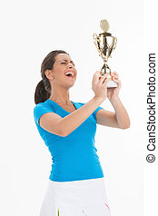 Women with sport trophy. Happy young women in tennis skirt...