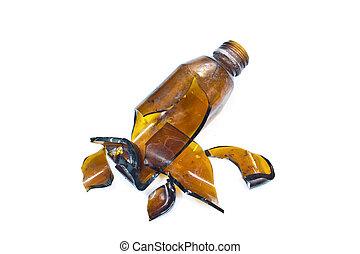 Broken brown bottle
