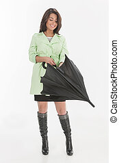 It?s raining outside. Attractive young women holding an...